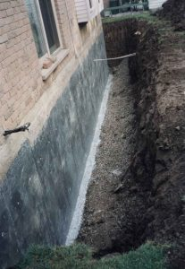Appearance of excavated poured concrete wall with visible footing