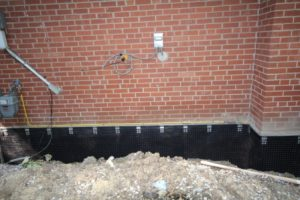 Appearance of waterproofed foundation wall prior to backfilling